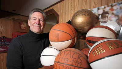 Former Nyack High School basketball coach Gary Gray pictured with a few sports mementos before his 2013 induction into the Rockland County Sports Hall of Fame. Gray is one of four Section 1 coaches being inducted into the New York State Basketball Hall of Fame March 26, 2017.