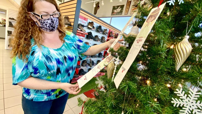 Danielle Cline looks at cards on the Angel Tree inside Shope's Shoes of Shelby.