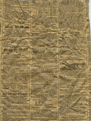 An old newspaper with information and dates from the 1800s.