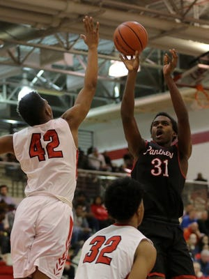 Kris Wilkes (31) puts up a shot in North Central's win over Pike on Friday night.