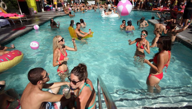 Partiers crowd the pool at the Saguaro Hotel in Palm Springs during the inaugural Splash House: A Palm Springs Pool Party in Aug. 2013.