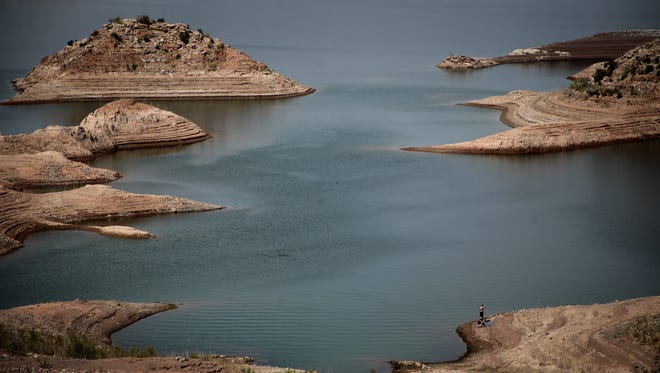 Lines on the shore of Lake Mead show the reservoir's receding water levels.