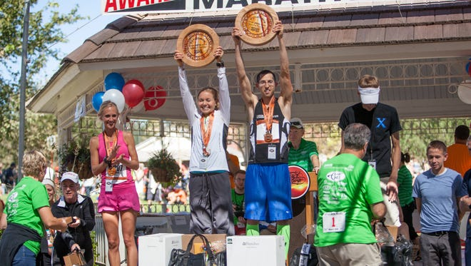 First Overall Female Amber Green and First Overall Male Aaron Metler receive their awards after the St. George Marathon Saturday, Oct. 4, 2014.
