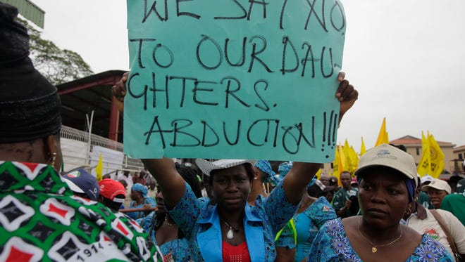 Women attend a demonstration calling on  government to rescue kidnapped schoolgirls of a government secondary school Chibok, in Lagos,  Nigeria.