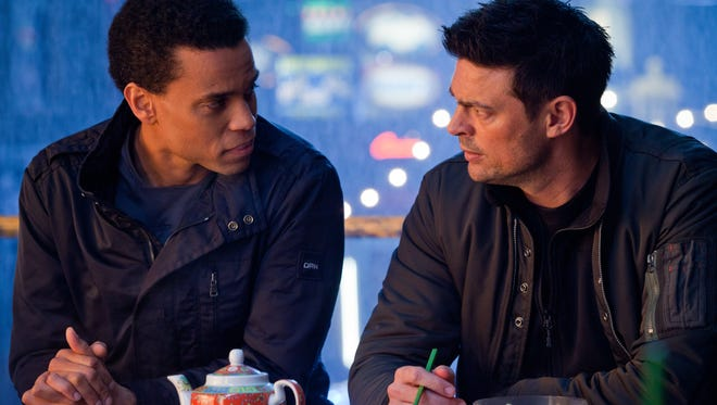Michael Ealy, left, and Karl Urban in Fox's 'Almost Human.'