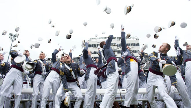 WEST POINT, NY - MAY 25: 2013 graduating cadets toss their hats after graduation at the United States Military Academy at West Point (USMA) during the 215 commencement ceremony May 25, 2013 in West Point, New York.