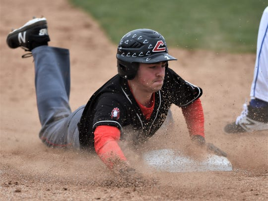 Coshocton's Griffin Mason slides into third base.