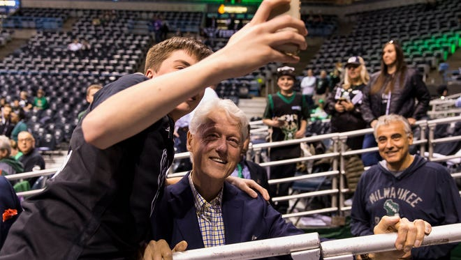 Bill Clinton snapped selfies with fans before the Bucks-Celtics game.