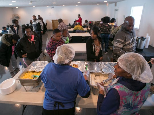 A line for the buffet at Temple of Believers Deliverance Church, Indianapolis, Saturday, March 3, 2018. The church offers a no cost breakfast, aimed as an aid to community members who could use a hot meal, coupled with a short sermon at 11am on Saturday mornings.