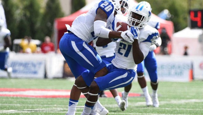 Middle Tennessee safety Kevin Byard (20) and cornerback Jamarcus Howard (21) intercept a Western Kentucky pass during the first half an NCAA college football game on Saturday, Oct. 10, 2015, at L.T. Smith Stadium in Bowling Green, Ky.