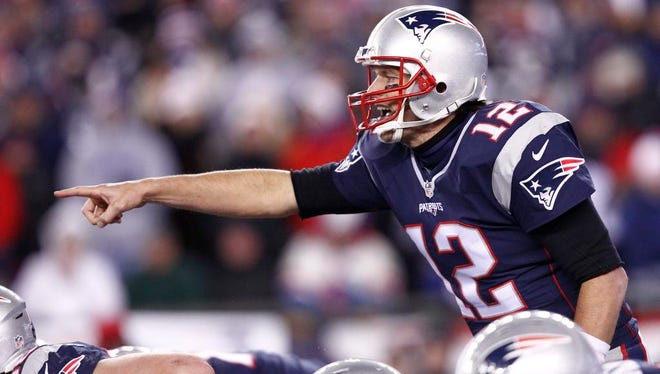 New England Patriots quarterback Tom Brady (12) points against the Buffalo Bills during the second half at Gillette Stadium.