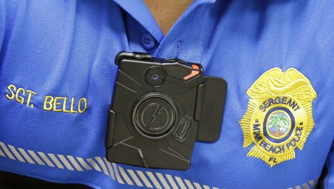 Miami Beach Police Sgt. Alex Bello wears a body camera at a news conference, May 5, 2015, in Miami Beach, Fla.