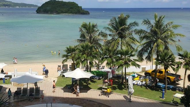 Tourists enjoy the beach in Guam's capital of Hagatna on July 14, 2017.