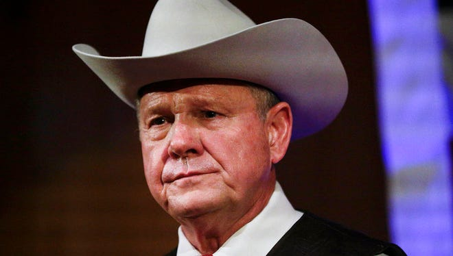 In this Monday, Sept. 25, 2017, file photo, former Alabama Chief Justice and U.S. Senate candidate Roy Moore speaks at a rally, in Fairhope, Ala. In the face of sexual misconduct allegations, Moore's U.S. Senate campaign has been punctuated by tense moments and long stretches without public appearances. Moore faces Democrat Doug Jones for Alabama's U.S. Senate seat in the Dec. 12 election.