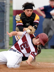 Gloucester Catholic catcher Sam Punzi loses the ball while tagging Ryan Stauffer of Eastern in the championship game of the Diamond Classic at Eastern High School. Stauffer was safe on the play.