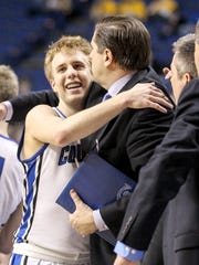 Cole VonHandorf gets a hug from assistant coach Joe