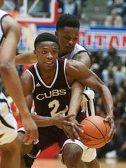 University of Detroit Jesuit high schools Elijah Collins drives against Ypsilanti Community high schools Garvin Crout during fourth period action on Tuesday, March 22,2016 at University of Detroit Mercy Calihan Hall.