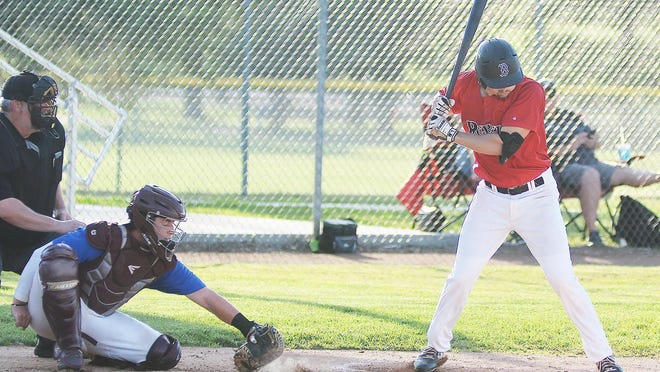 Newton Rebel Nolan Riley watches a pitch go into the dirt for Ball 4 during play Thursday against the Cheney Diamond Dawgs.
