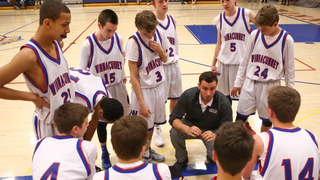 Jared Gillis talks with his Winnacunnet freshmen boys basketball team in a timeout during a game against Bedford in January 2016.