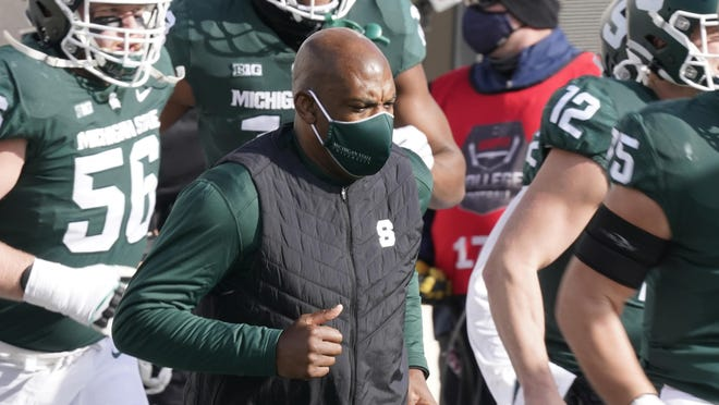 FILE - Michigan State head coach Mel Tucker runs onto the field before the first half of an NCAA college football game against Indiana in East Lansing, Mich., in this Saturday, Nov. 14, 2020, file photo. In a season of video conferences and empty seats, new Michigan State coach Mel Tucker is doing his best to help people get to know him.