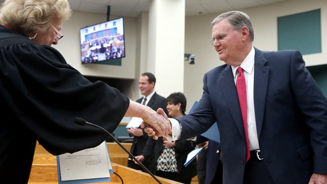 City Council member Joe McComb shakes hands with District Judge Janis Graham Jack after signing his oath of office Tuesday, Dec. 13, 2016, at City Hall in Corpus Christi.