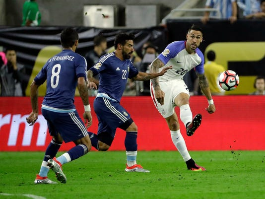 United States's Geoff Cameron (20) is defended by Argentina's Ezequiel Lavezzi (22) during a Copa America Centenario semifinal soccer match Tuesday, June 21, 2016, in Houston. (AP Photo/David J. Phillip)