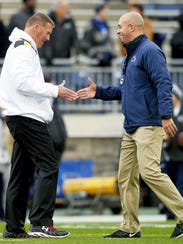 Former Maryland head coach Randy Edsall and Penn State head coach James Franklin shake hands in Beaver Stadium before their 2014 game. A bit later, Edsall earned arguably his biggest victory with the Terps. Now, back at UConn, Edsall said big money is ruining college football ... and leaving behind the players, unfairly.