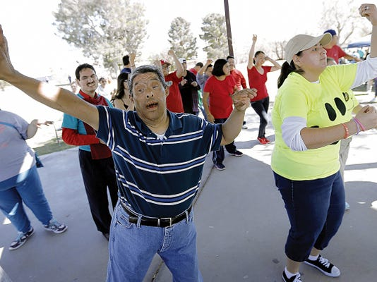 Adrian Gomez has fun doing a Zumba move Friday at Memorial Park.