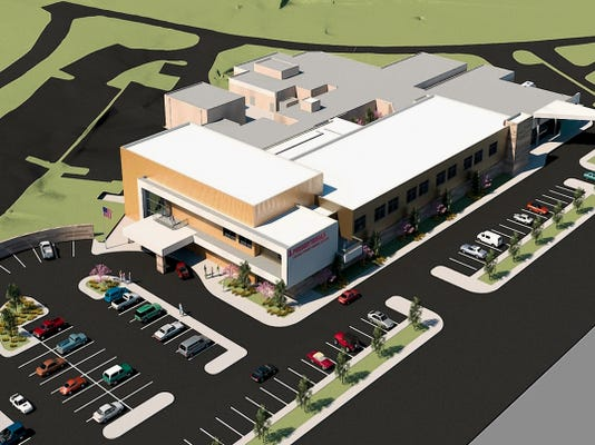 A conceptual aerial view of the hospital with additions and renovation.
