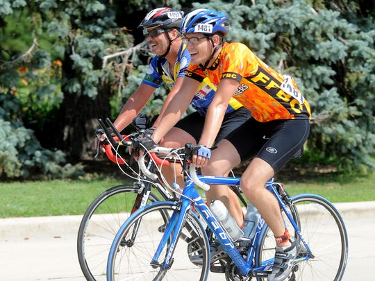 Walter Baade, 1497, and Walter Wenzel approach the finish of the Race The Lake bike race in Fond du Lac on August 17, 2014.