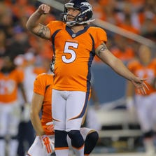 DENVER, CO - AUGUST 23:  Kicker Matt Prater #5 of the Denver Broncos watches the flight of a missed 49-yard field goal attempt in the second quarter during a preseason game against the Houston Texans at Sports Authority Field at Mile High on August 23, 2014 in Denver, Colorado.  (Photo by Justin Edmonds/Getty Images)