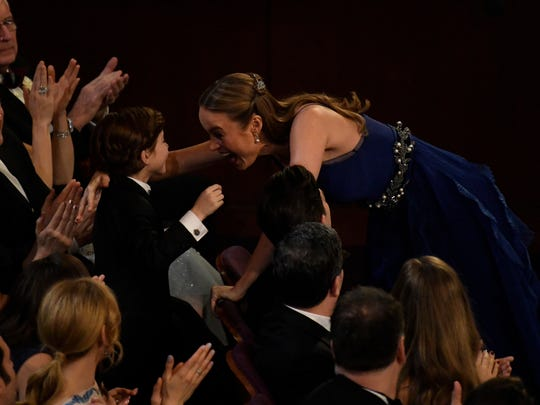 Best actress winner Brie Larson celebrates her win with co-star Jacob Tremblay.