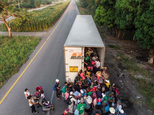 "Migrants get on a truck, near Pijijiapan,Mexico on October 26, 2018. The Pentagon is expected to deploy about 800 troops to the US-Mexico border, two US officials told AFP on Thursday, after President Donald Trump said the military would help tackle a ""national emergency"" and called on a caravan of US-bound migrants to turn around."