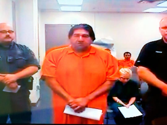 """Immokalee resident Henry """"Big Rick"""" Contreras, 48, appears on closed circuit television for a first appearance hearing in a Collier County courtroom on Sunday, May 18, 2014, in Naples. Contreras is accused in two Orange County home invasions will be held in Collier County without bond pending his extradition back to Central Florida."""