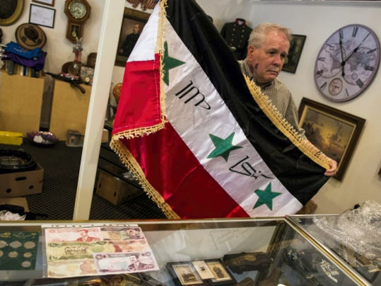 An Iraqi flag brought back by a solider who fought in the Iraq War at the Collector's Exchange in Annville has a variety of antiques, specializing in fine antiques, estate jewelry, diamonds, fine watches, clocks, military items, swords, Civil War items, rare antique firearms, and gold & silver coins. You can buy, sell and trade.  Jeremy Long -- Lebanon Daily News