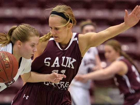Sauk Centre sophomore Maesyn Thiesen (23) pressures Norwood-Young America junior Shyann Wickenhauser (2)  during the first half of the Class 2A girls basketball tournament quarterfinal game Wednesday at the University of Minnesota's Mariucci Arena in Minneapolis. The Mainstreeters led Norwood-Young America 45-25 at halftime.