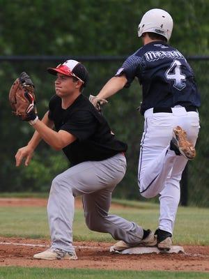 This throw to Livonia Churchill first baseman Jack Behen nips Plymouth baserunner Jared Merandi during Saturday's district semifinal.