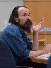 Michael Rodgers sits in the courtroom of Judge Thomas