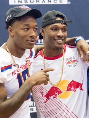 Gator wide receiver Jacob Copeland, left, poses with PHS graduate and current Green Bay Packers cornerback Damarious Randall after receiving his Under Armour All-American game jersey during a ceremony at Escambia High School in Pensacola on Thursday, October 26, 2017.
