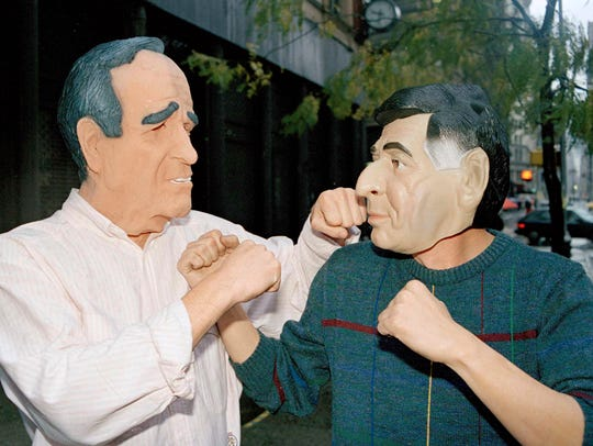 Men dressed as Vice President George Bush (left) and