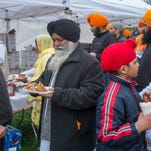 Sikhs from around Michigan gather at Lansing's Ferris Park to celebrate the annual Sikh Day in Lansing Saturday, April 25, 2015. The event features free food, various vendors and culminates with a parade.