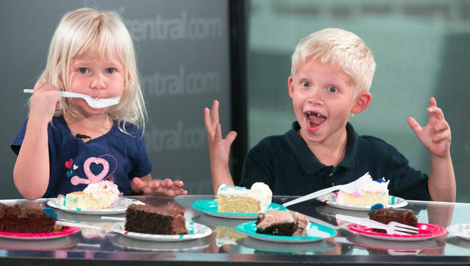 Charlotte Rough, 3, and her brother, Scott Rough, 6, taste test sheet cake.