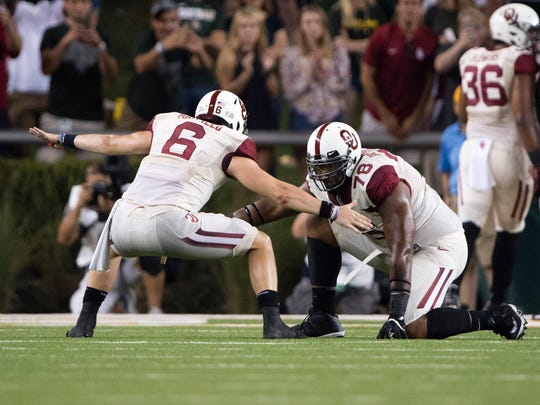 Sep 23, 2017; Waco, TX, USA; Oklahoma Sooners quarterback Baker Mayfield (6) and offensive lineman Orlando Brown (78) celebrates a touchdown against the Baylor Bears during the second half at McLane Stadium. The Sooners defeat the Bears 49-41.
