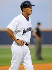 Blue Wahoos coach Jim Riggleman watches the batting action from third base Friday in a game against the Montgomery Biscuits at Maritime Park Stadium.