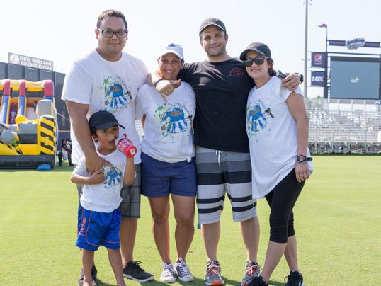 636482404300013649-Friends-and-family-gathered-to-celebrate-Steps2Acceptance-at-Steps-for-Autism.jpg
