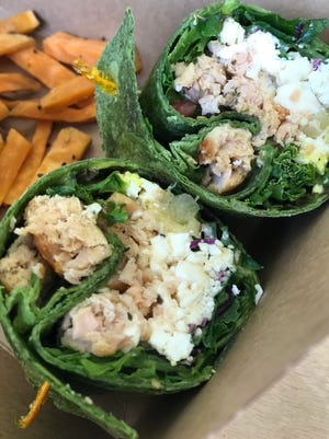 A Fibrre wrap, Montego-style, with salmon, added feta and sweet potatoes.
