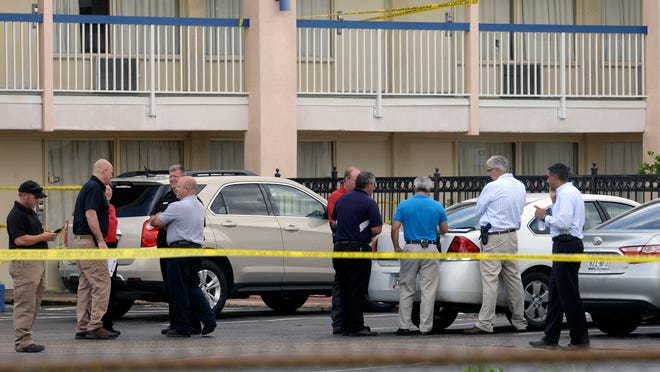 Law enforcement respond to a shooting at the Days Inn in Bossier City, La. May 26, 2015 that allegedly saw at least one federal agent shot. Reports say the incident was over an Amber Alert with the child found alive but her alleged abductor was killed in the incident with authorities.