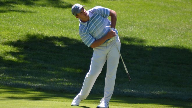 James Nicholas leans in hopes of influencing a wedge into the ninth green that was pulled slightly left Tuesday during the second round of the Met Open at Glen Oaks.