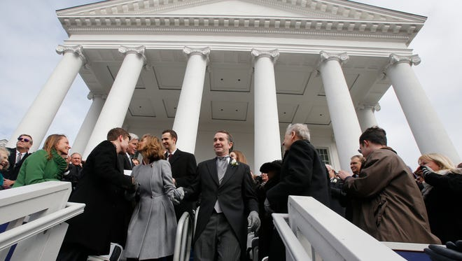 Governor-elect Ralph Northam and his wife, Pam, walk to the inaugural platform prior to his taking the oath of office during inaugural ceremonies at the Capitol in Richmond, Va., Saturday, Jan. 13, 2018. (AP Photo/Steve Helber)