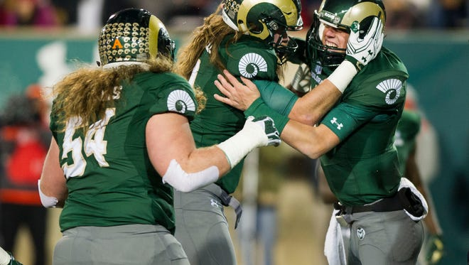 Colorado State Rams quarterback Nick Stevens (7) celebrates scoring a touchdown with tight end Dalton Fackrell (30) in the first quarter of the game against New Mexico Saturday, Nov. 19, 2016 at Hughes Stadium in Fort Collins, CO. This is the final game played in Hughes Stadium, which opened in 1968.